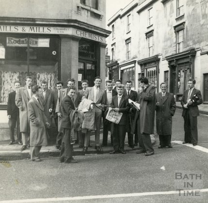 A group of men standing outside Mills & Mills chemists in Larkhall, 1950s