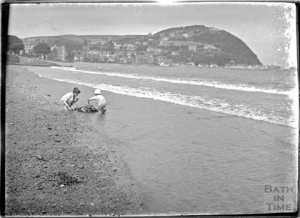 One of the photographer's twins and a friend on the beach at Minehead, Somerset , c.July 1920