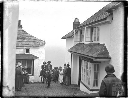 Riding a donkey up the cobbles, Clovelly, North Devon, c.1930s