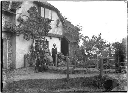 A group portrait in the back garden of an unidentified house c.1920s
