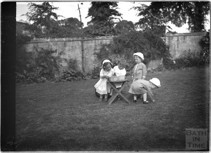 Children playing in a garden  c.1915