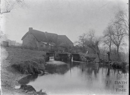 An unidentified stretch of river and building c.1910