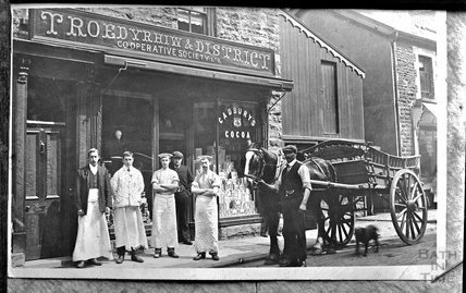 Portrait of a group of people outside Troedyrhiw & District Cooperative Society shop, Wales c.1900s