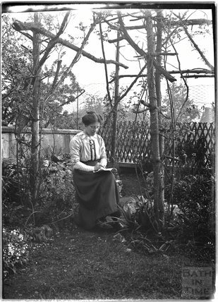 The photographer's wife Violet in their back garden in Sydney Buildings c.1920s