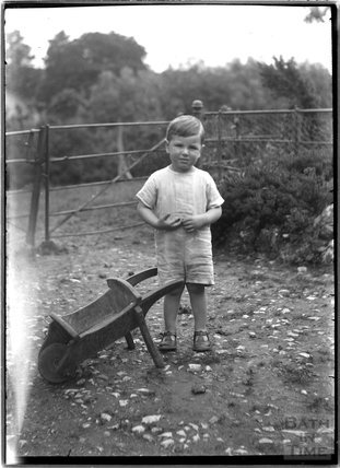 A boy with a wheelbarrow c.1920