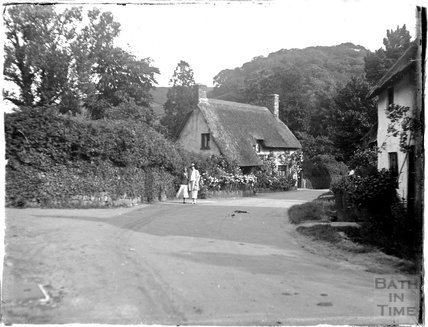 An unidentified village scene with thatched cottage c.1920s