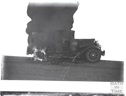 Is this the photographer's car on fire? c.1920s