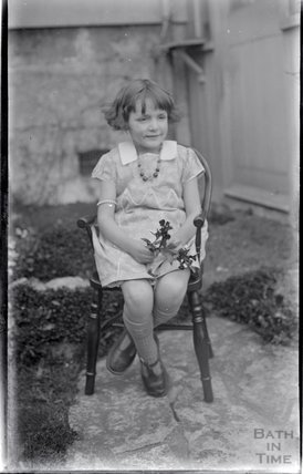 An unidentified young girl posing at no 32 Sydney Buildings c.1919