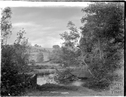 A picturesque riverside scene c.1920s