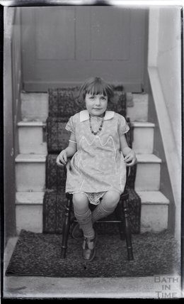 An unidentified young girl posing inside no 32 Sydney Buildings c.1919