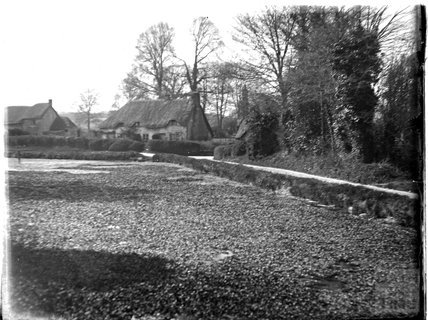 An unidentified lane with thatched cottages c.1910