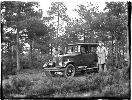 Posing beside the photographer's car c.1920s