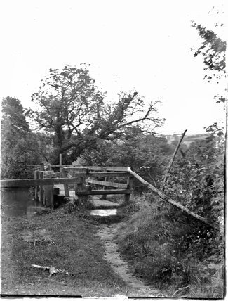 A wooden bridge over an unidentified river or canal c.1920s