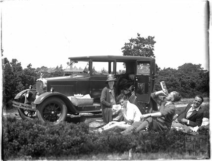A picnic party with the car in the background c.1920s