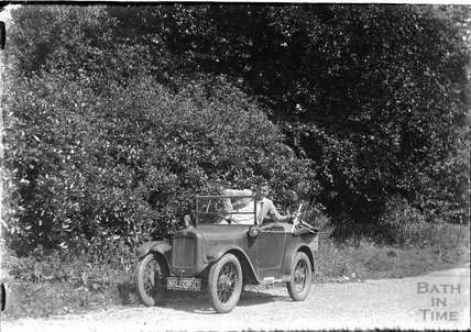 A young man in his open topped car c.1930s