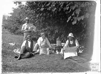 Friends of the photographer picnicking and boating on the river near Warleigh c.1910s