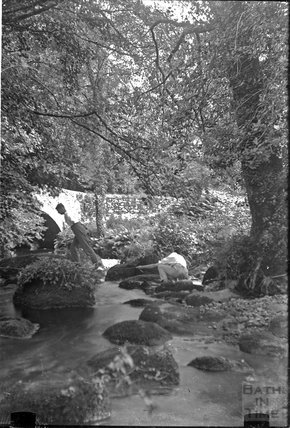 The photographer's twins by a stream in a forest near Brixham c.1930s