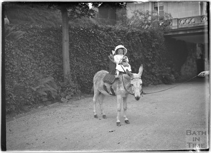Small girl on a donkey Monkton House, Warminster Road, Limpley Stoke c.1910s