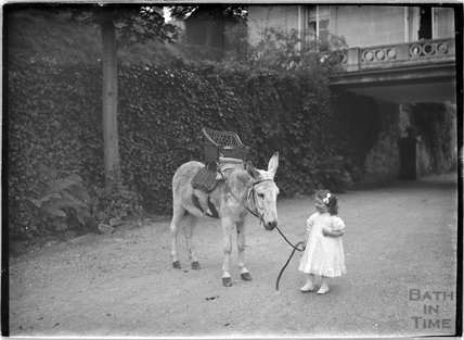 Small girl with a donkey Monkton House, Warminster Road, Limpley Stoke c.1910s