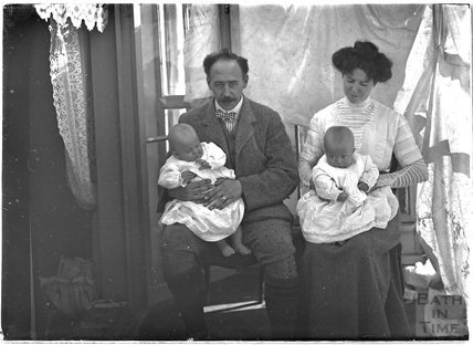 The photographer, his wife and twin sons, September 1911