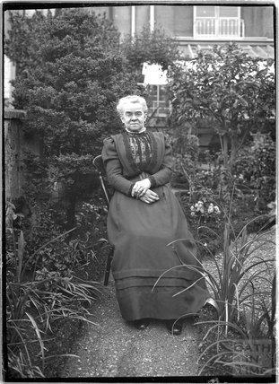 Mrs Unwin in her garden c.1910