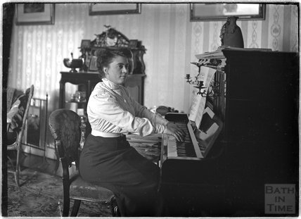 Lady playing the piano c.1906