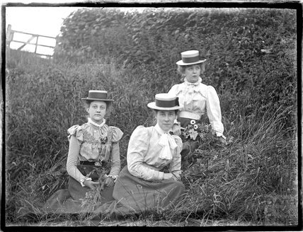 Three ladies in a meadow, possibly at Bathampton Down c.1900