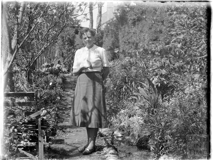 Unidentified lady in a garden c.1900