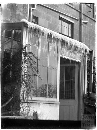 Icicles on the door to the back garden, Sydney Buildings c.1910