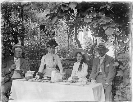 Taking tea in the garden c.1900