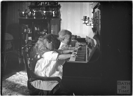 The photographer's twins Rupert and Roy playing the piano, Sept 1912