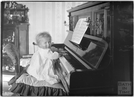 One of the photographer's twins playing the piano, Sept 1912