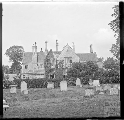 Large unidentified house, possibly a Rectory, beside a churchyard, c.1890s