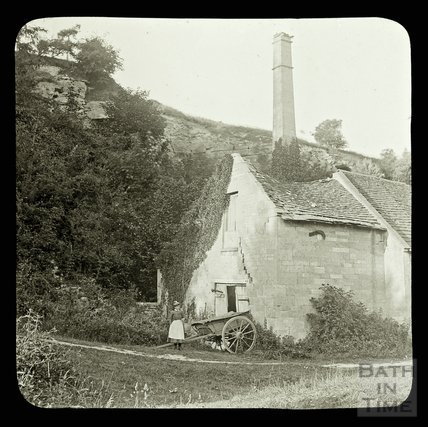 A lady next to a decaying industrial building at the quarry at Murhill, near Limpley Stoke c.1890s