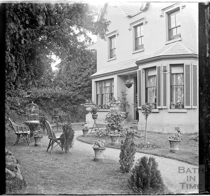 A tranquil garden with chairs outside an unidentified house, c.1900s