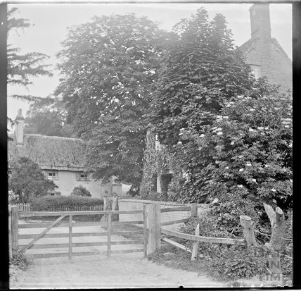 Unidentified house behind gates, c.1890s