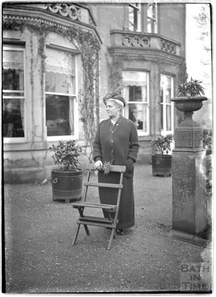 A lady outside Monkton House, Limpley Stoke c.1910s