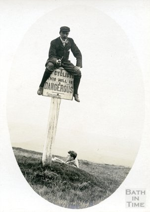 The photographer or one of his friends on a sign, c.1890s