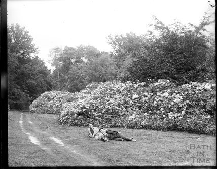 The photographer and a friend lying in the grass, c.1890s
