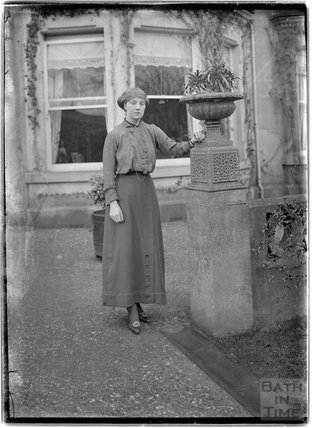 A lady posing in front of Monkton House, c.1900s