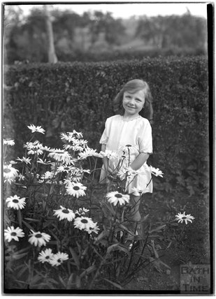 Portrait of a small girl in the garden, c.1920s or 1950s?