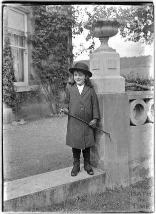 A young girl outside Monkton House, Limpley Stoke c.1910s