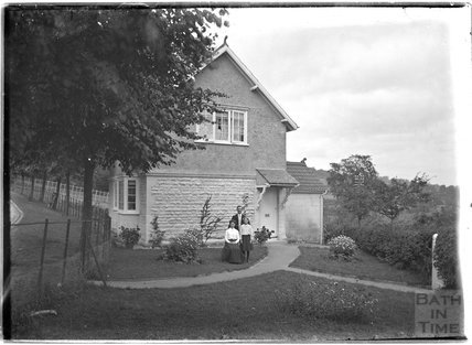 Outside the lodge building at the end of the drive to Monkton House, c.1910s