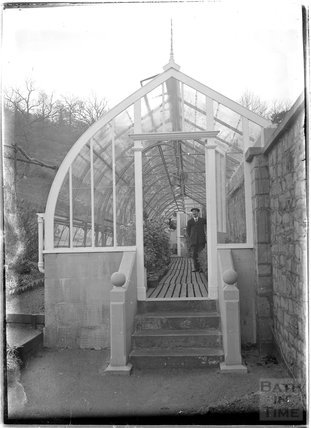 Greenhouse and gardener at Monkton House, c.1910s