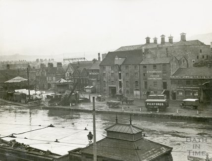 View across the river to Broad Quay in flood, Bath, c.1920s