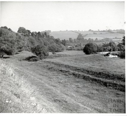 Somersetshire Coal Canal, Line of main canal (foreground) and junction with Radstock branch aqueduct on Right Hand October 7th 1951
