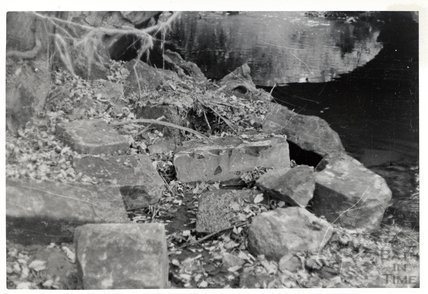Somersetshire Coal Canal, Midford aqueduct East Side, fallen blocks of masonry from arch and parapet above,  November 16th 1968