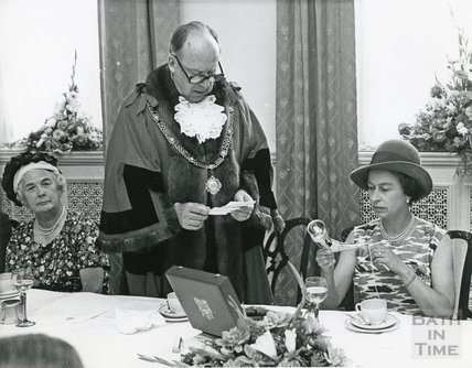 Queen holding a Saxon drinking horn presented to her by the Mayor during lunch at the Pump Room August 9th 1973