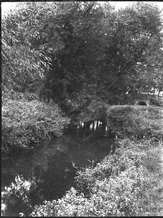 Unidentified stream with bridge, c.1910