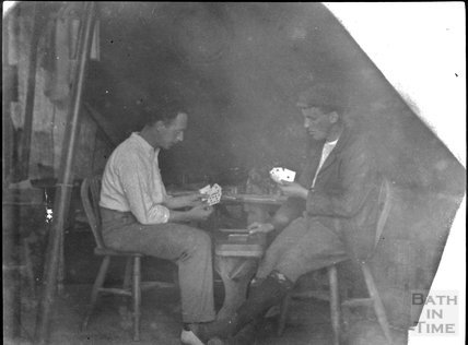 Passing time playing cards, unidentified military camp, c.1900s